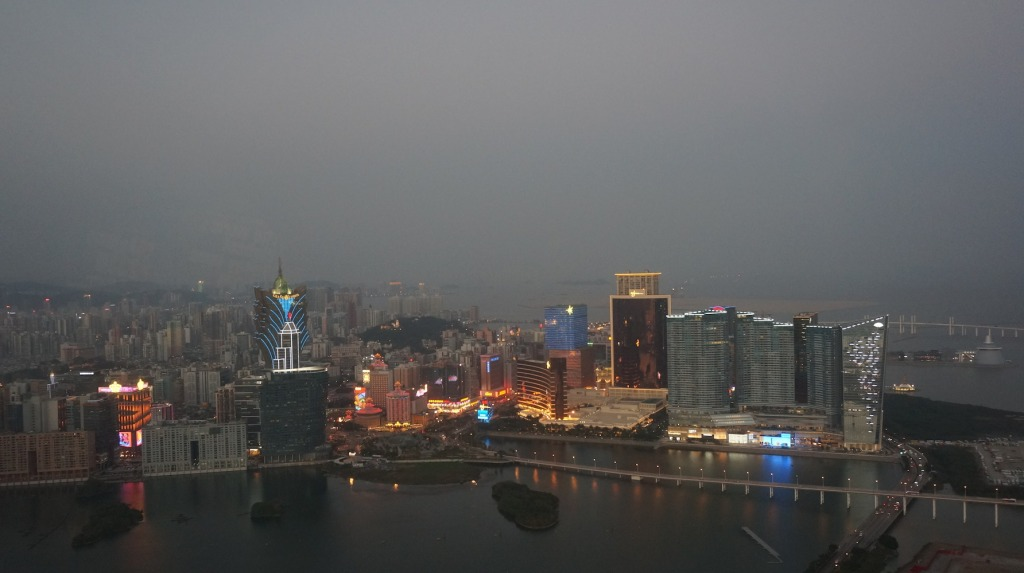 The lights come on, from the top of Macau Tower